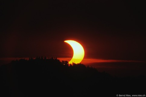 Partial solar eclipse at sunrise on 31 May 2003, shot from Bachtel Tower in Zurcher Oberland